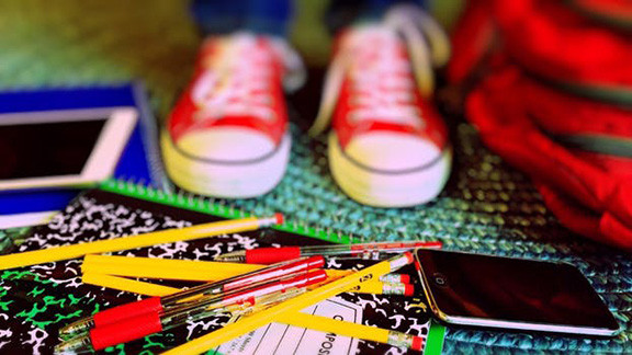 Young Person with Binder and Pencils