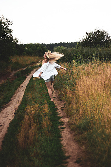 Woman Running on Dirt Road