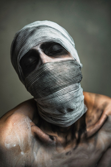Depressed Person with Bandage on Head