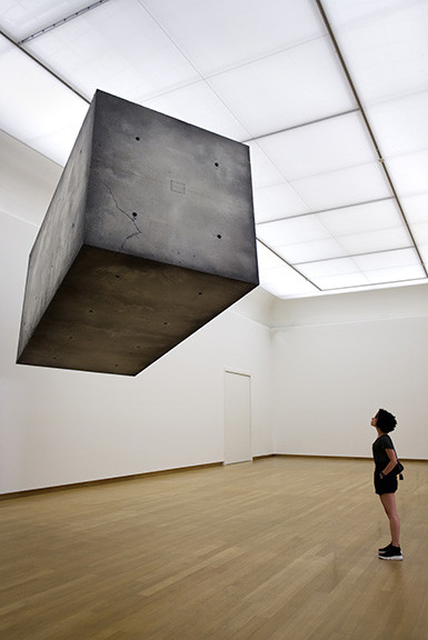 Woman in Museum Looking at Floating Box
