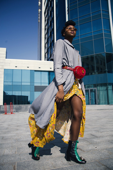 Black Woman Yellow Skirt with Red Purse