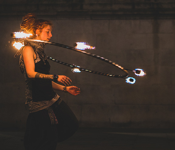 Woman with a fire hoop