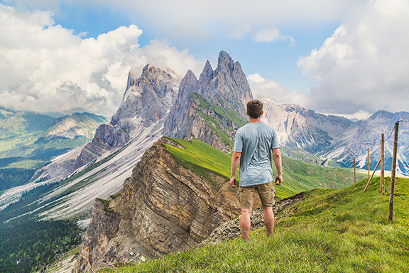 Man Looking At a Beautiful Mountain