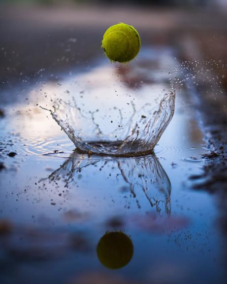 Tennis Ball Splashing in Water