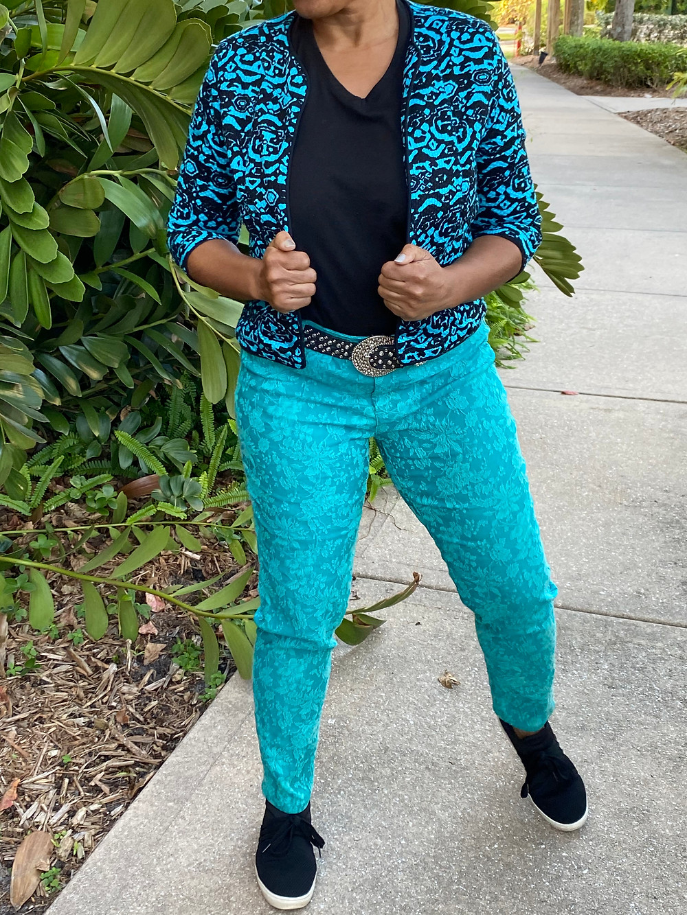 Woman wearing turquoise pants