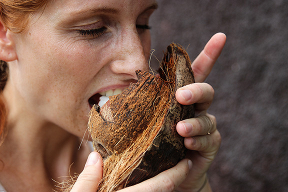Woman Eating Coconut