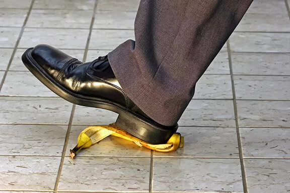 Business person slipping on banana