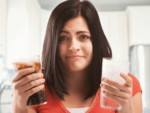 Woman Choosing Between Soda and Water