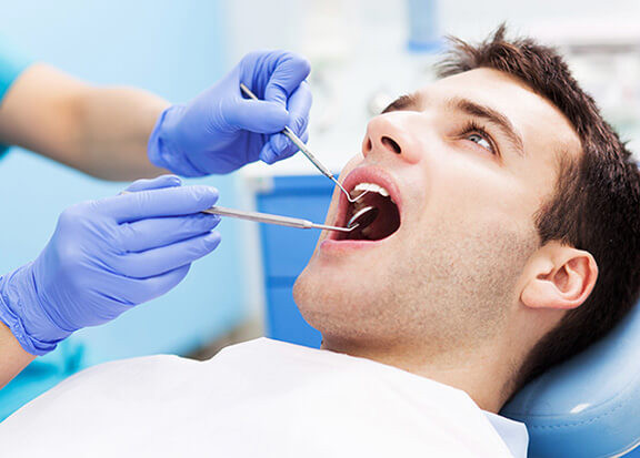 Man Getting Checkup at the Dentist