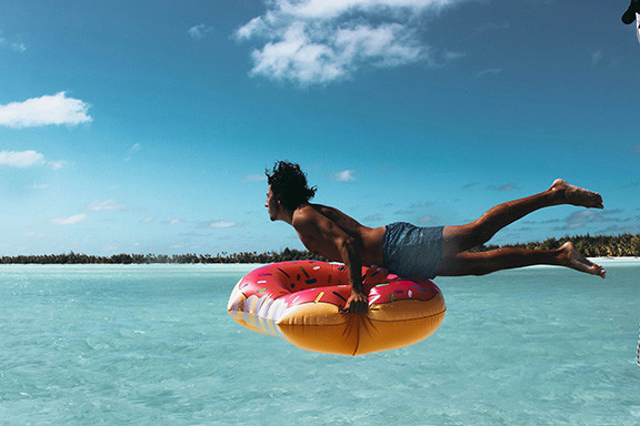 Guy on a Beach Tube In Water