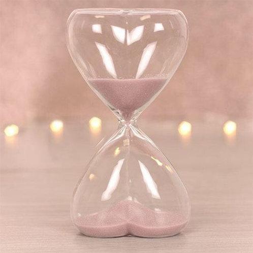 Pink sand heart hour glass