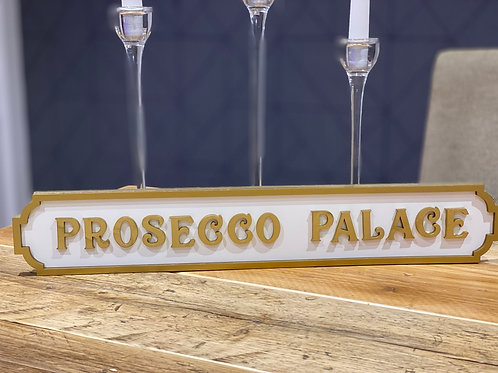 Prosecco Palace white and gold sign