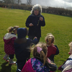 Outdoors talking about seeds and wind dispersal