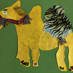 We had lots of fun making camels for our walls!