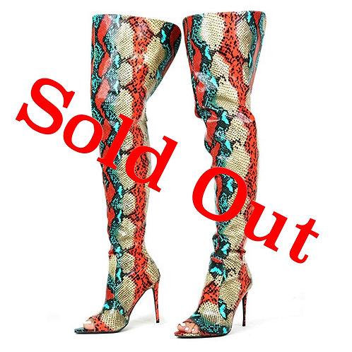 Muliticolored snakeskinned boots peep toe
