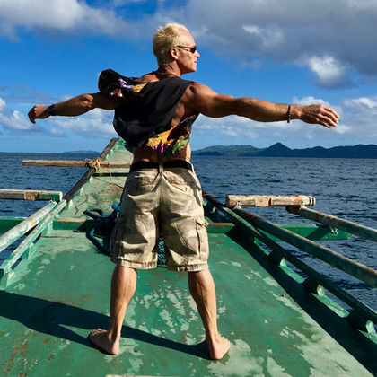 Terry Mulrooney San Francisco landscape garden designer on a boat in the Philippines.