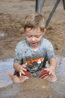 Kaleb in mud