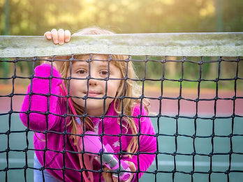 girl-looking-through-the-tennis-net-Y463