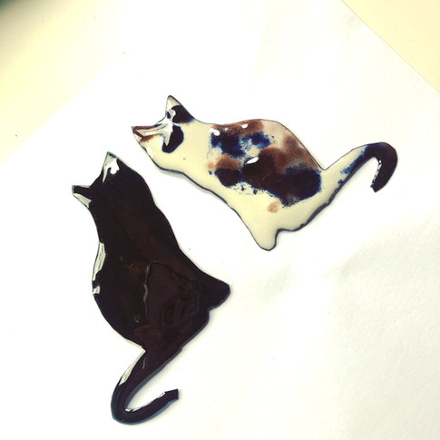 Enamelled cats