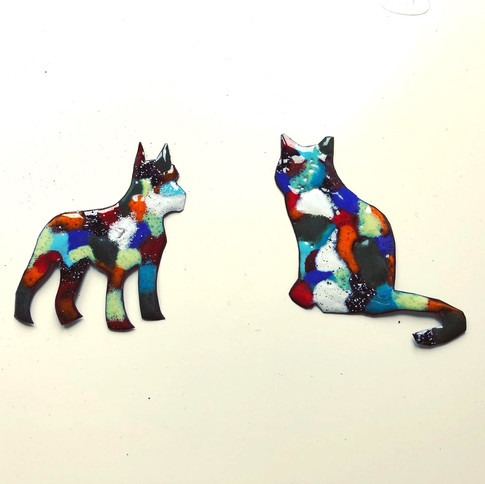 Enamelled dog and cat.