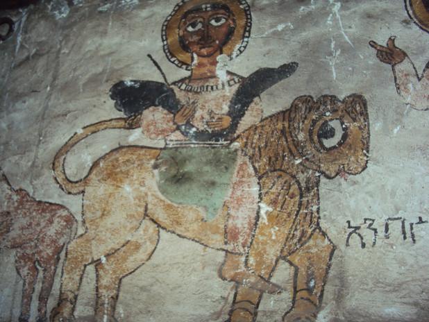 Painting of a monk-saint riding a lion in Ǝmäkina Mädḫane 'Aläm church