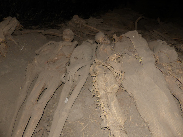 Part of the large assemblage of naturally desiccated mummies, articulated skeletons and commingled bones at the back of the cave
