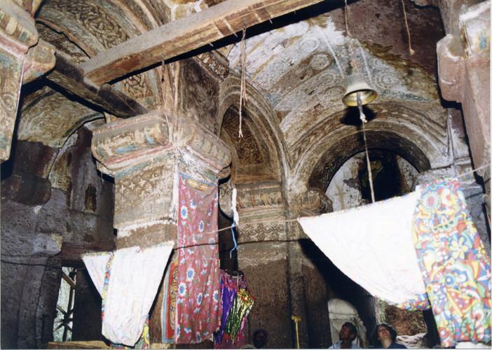 The interior of Bǝlbäla Č̣ärqos church. The surviving paintings are clearly similar in style to those in Gännätä Maryam