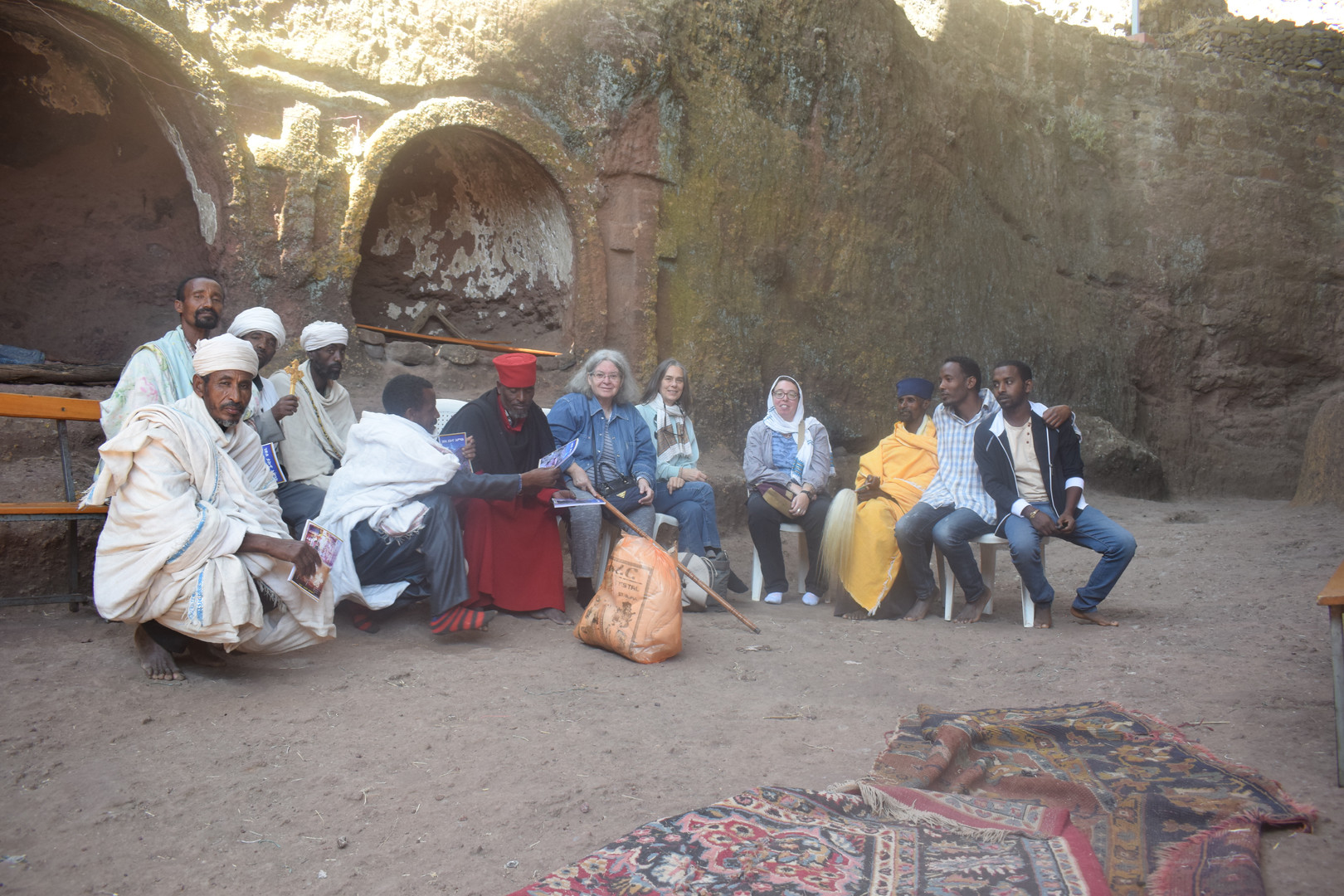 Priests at Gännätä Maryam presenting Project members with copies of the newly published Amharic version of the Life of King Yǝkunno Amlak, sponsored by the Project (January 2020)