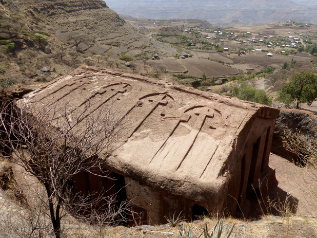 The view from the church over Gännätä Maryam village and the Täkkäze valley beyond. The unusual carved roof resembles that of the church of Mädḫane 'Aläm in Lalibela
