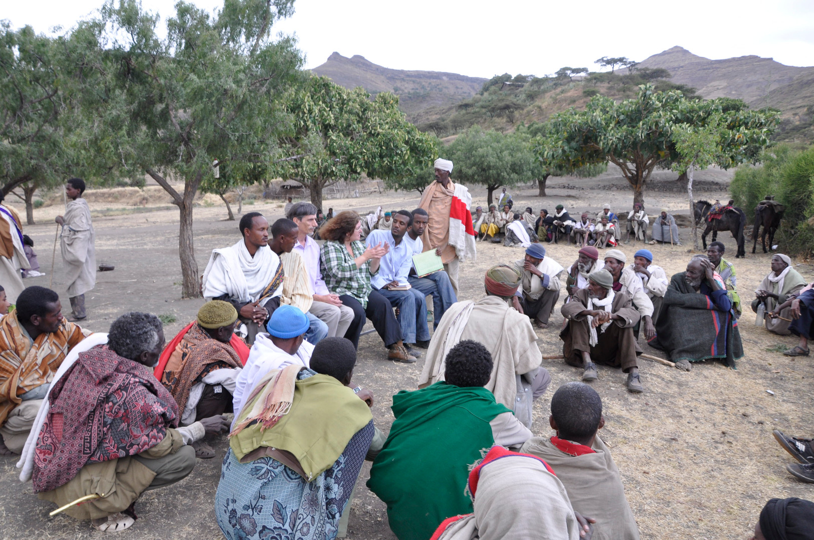 Tania, Chris and Habtamu discussing the project with the local community at Gännätä Maryam, 2009