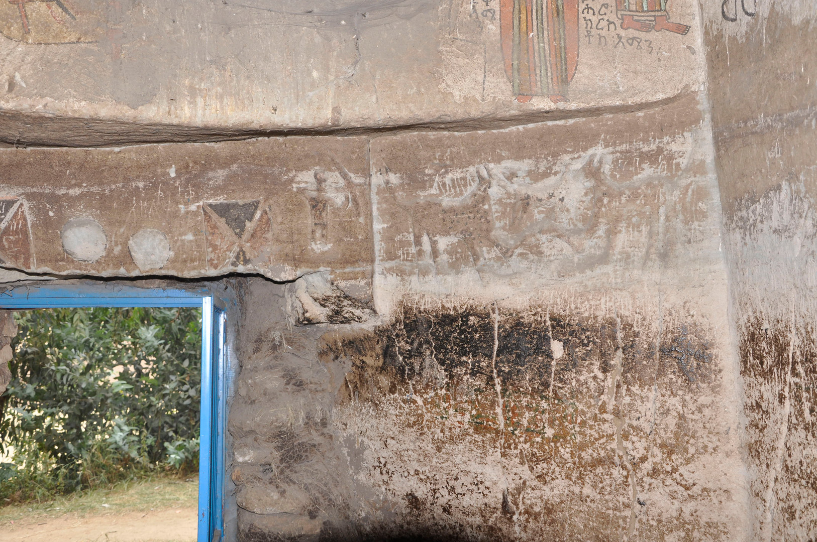 Abrasion at shoulder/head height on the walls of Wašša Mika'el church may have obliterated some of the low reliefs