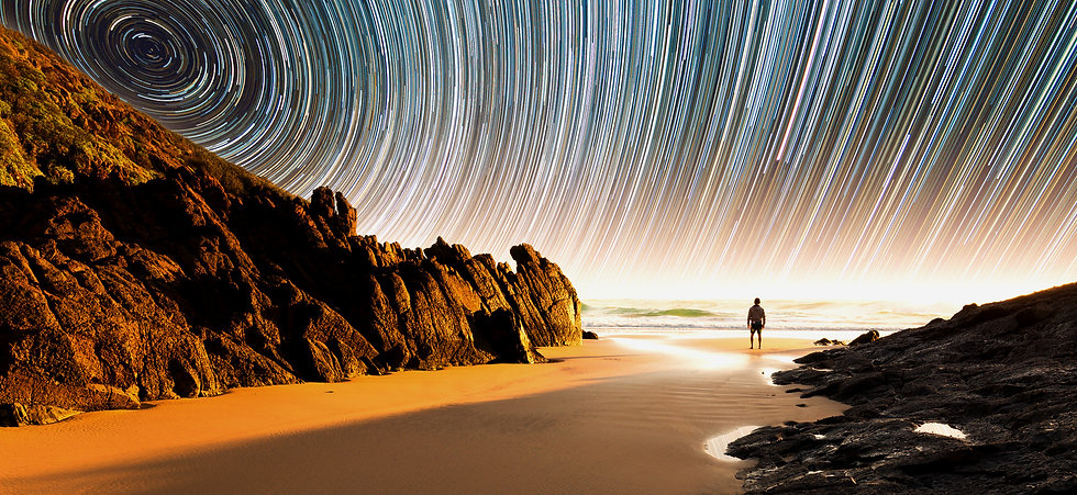 Man on beach and star timelaps_edited.jpg