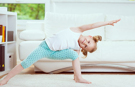 little girl doing yoga