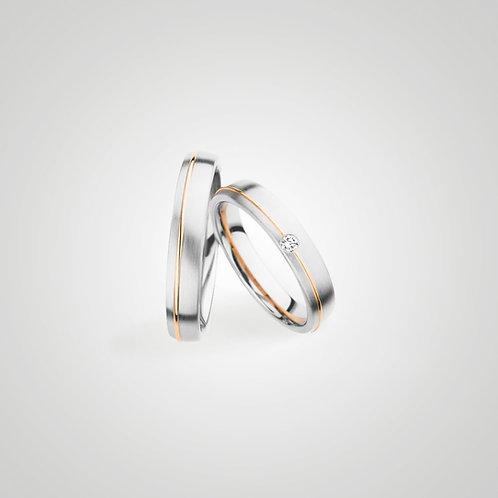 Aros oro blanco con línea oro amarillo y diamante
