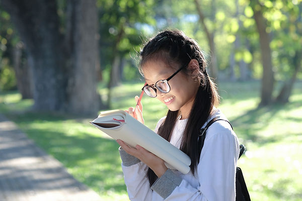 asian-girl-student-holding-pencil-and-standing-rea-2021-04-02-22-21-37-utc.jpg