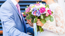 Wedding flowers, a bride and groom with a beautiful wedding bouquet and matching buttonhole