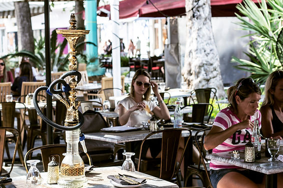 Gold khalil mamoun hookah displayed on a table