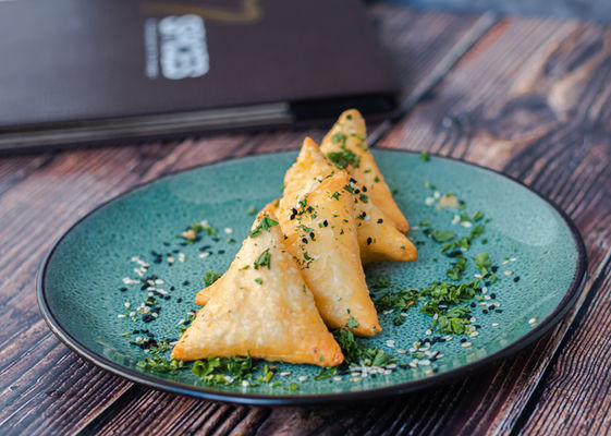 Cheese sambousek, lebanese appetizer consisting of fried filo pastry stuffed with halloumi cheese
