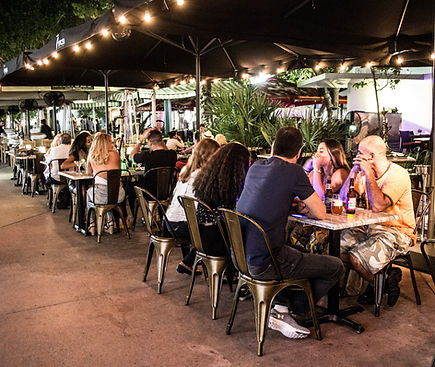 Crowd of diners enjoying a meal at 7 SPICES