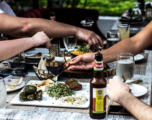 Friends sharing the mediterranean sampler appetizer