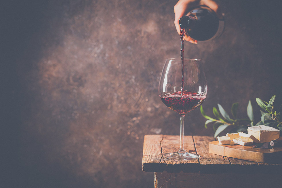 bigstock-Pouring-Red-Wine-Into-The-Glas-402633914.jpg
