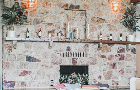 RELAX AND SIP BY THE FIREPLACE