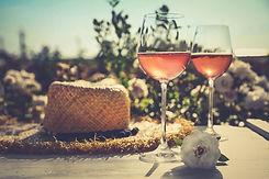 bigstock-Glasses-Of-Rose-Wine-Straw-Ha-3
