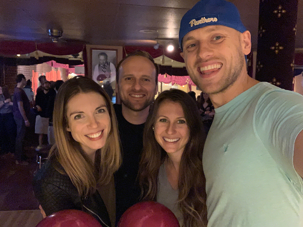 four friends smiling and having a great time during double date at arsenal bowling alley in Lawrenceville in Pittsburgh