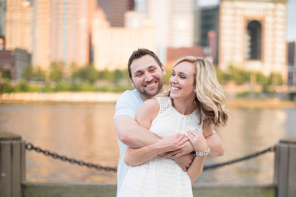 In love Couple having fun and playing at downtown Pittsburgh engagement shoot on north Shor