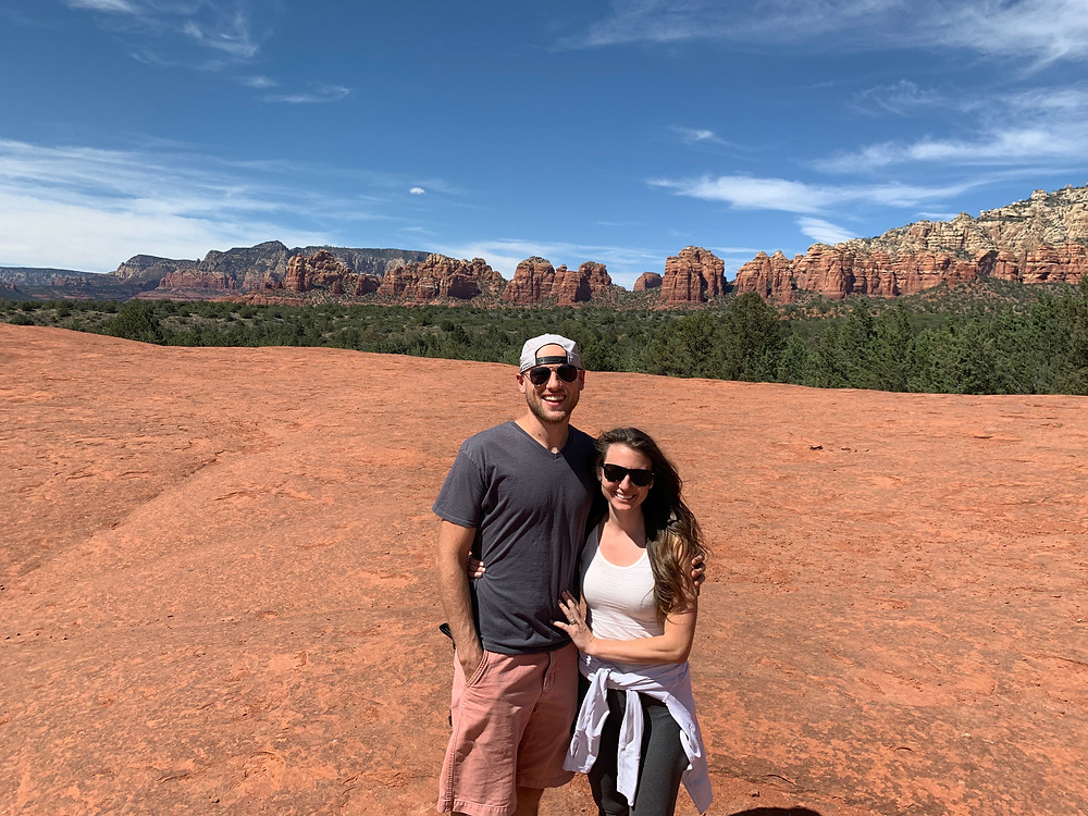 husband and wife on vacation in sedona arizona on the broken arrow pink jeep tour