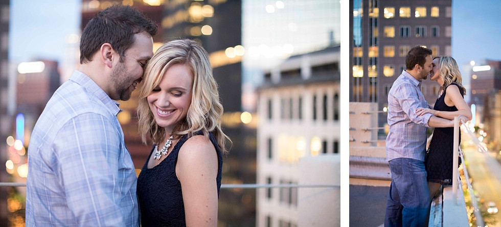 Couple in love on a parking garage rooftop smiling and kissing in the heart of downtown Pittsburgh