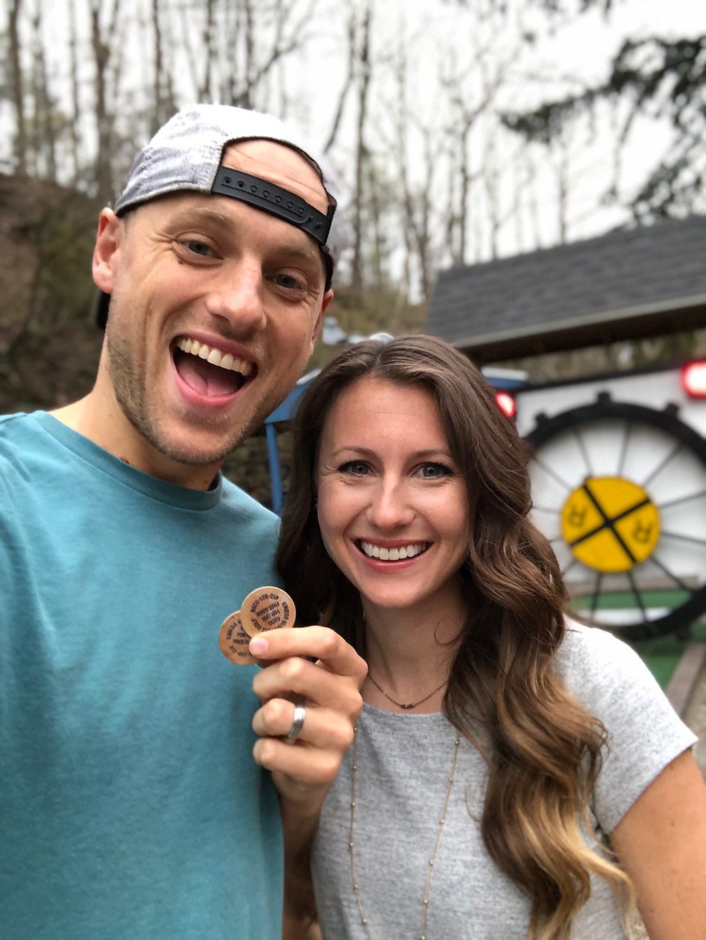 young married couple out for a fun date night playing mini golf in pittsburgh, pennsylvania
