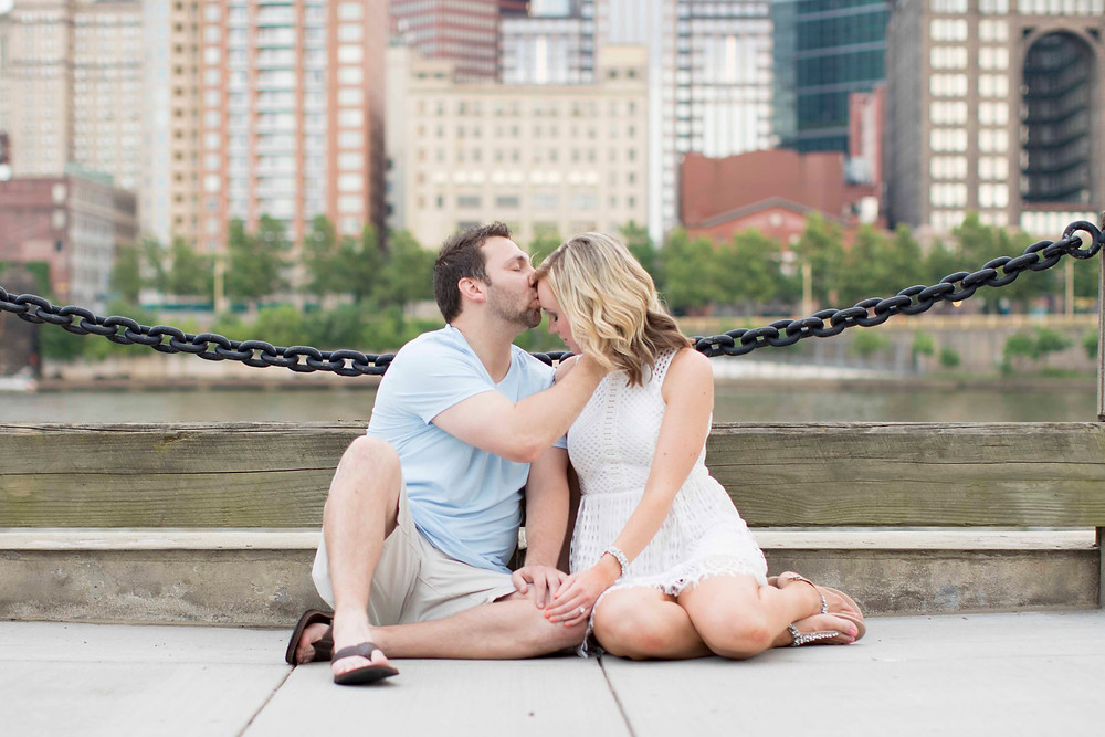 Couple city on river walk on north shore in downtown Pittsburgh for their engagement photoshoot