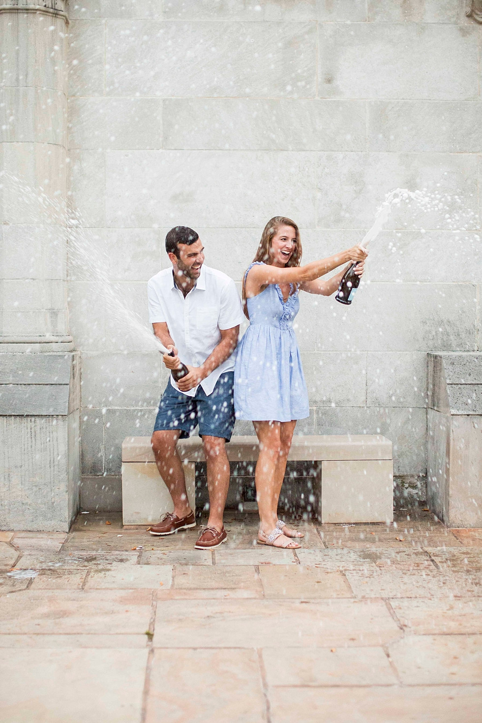 couple having a blast and popping champagne together